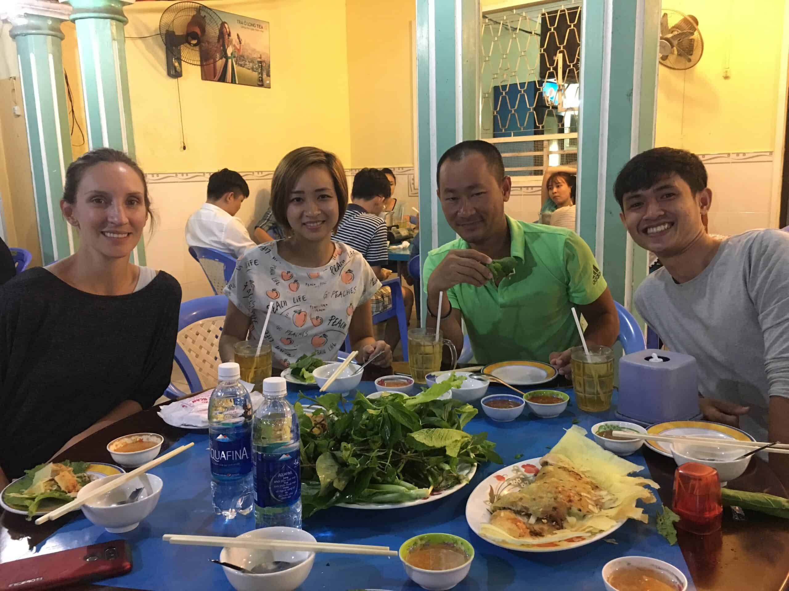 Jackie and I eating with our hosts in Vietnam